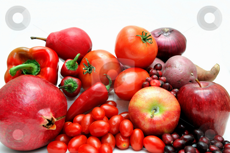 Red Fruit And Vegetables stock photo, Various fruits and vegetables all with red coloring including bell pepper, hot chilies large and small tomatoes apples and cranberries by Lynn Bendickson