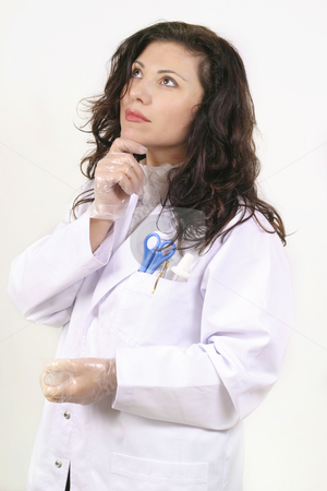 Medical ponderings stock photo, Intelligent young doctor thinking and looking up, perhaps to your message. by Leah-Anne Thompson