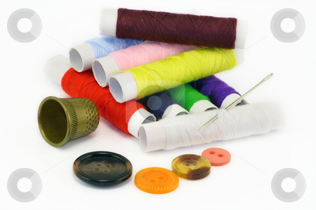 Multi-coloured threads and needles stock photo, All for fast repair of clothes. Threads, a needle, a thimble and buttons. by Aleksandr Volokov