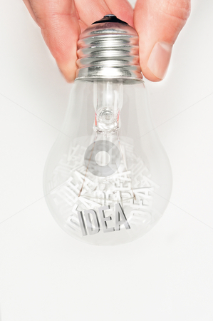 Hand with light bulb full of ideas stock photo, Hand shaking a bulb with a lot of