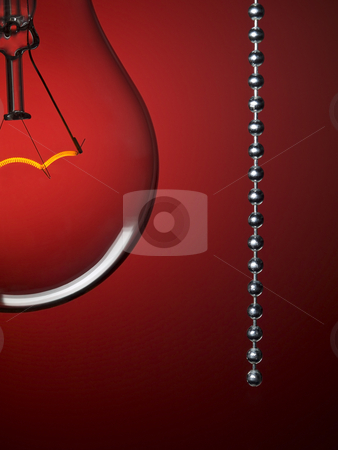 Turn off the light stock photo, Close up on a transparent light bulb with a pull switch over a red background. by Ignacio Gonzalez Prado