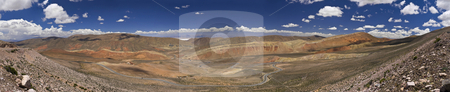 Northwest of Argentina stock photo, Wide panorama of a rocky desert taken on the northwest region of Argentina. You can see the salt lake far behind the mountains. by Ignacio Gonzalez Prado