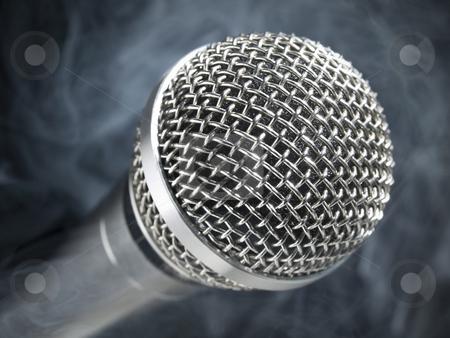 Microphone on stage stock photo, A dynamic microphone on stage. by Ignacio Gonzalez Prado
