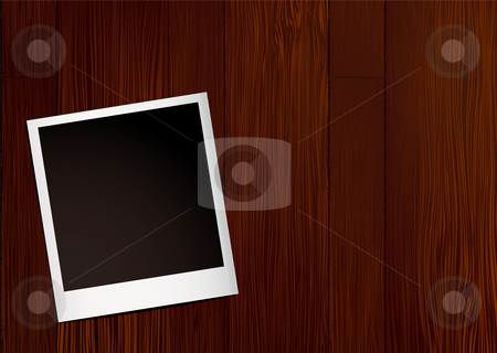 Instant photo wood stock vector clipart, Blank instant photo laying on a wooden desk top with grain by Michael Travers