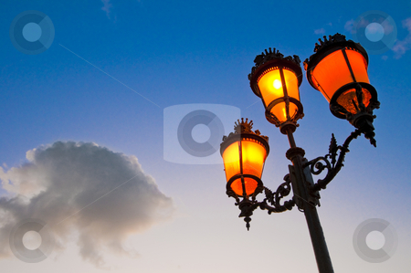 Streetlamp stock photo, One of the many streetlamps located at es Born Square, Ciutadella, Minorca Island. by Anibal Trejo