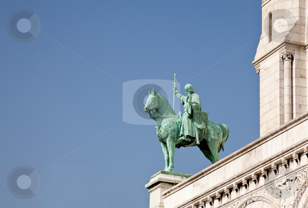Bronze statue of horseman guards Sacre Coeur stock photo, One of the green bronze statues on the edge of Sacre Coeur in Paris by Steven Heap