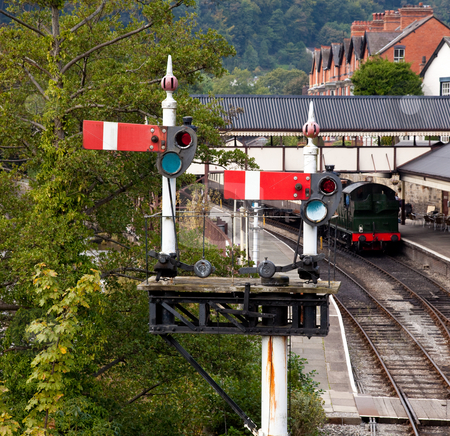 Llangollen station in Wales with the semaphone signals at red stock photo, View of the station platform in Llangollen in Wales framed by signals by Steven Heap