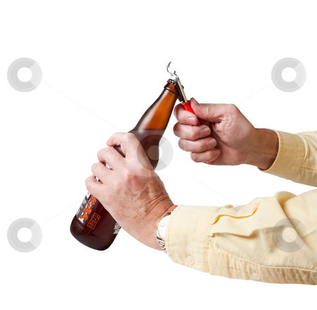 Cap being removed from beer bottle stock photo, Bottle cap being removed from brown cold beer bottle by Steven Heap