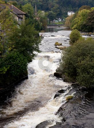 River runs rapidly through Llangollen in Wales stock photo, Rapids on River Dee in Llangollen in Wales by Steven Heap