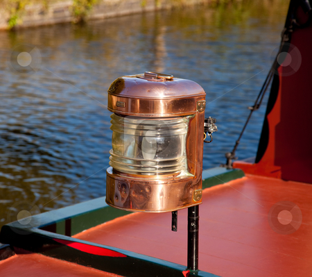 Ornate brass driving lamp on canal barge stock photo, Polished brass lamp on the bow of a canal barge by Steven Heap