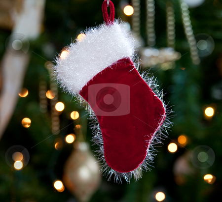 Fur lined stocking in front of xmas tree stock photo, Backlit fur stocking in front of out of focus christmas tree and lights by Steven Heap