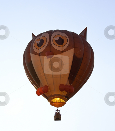 Hot air balloon shaped like an owl stock photo, Hot air ballon in the air with the shape of an owl with eyes and ears by Steven Heap