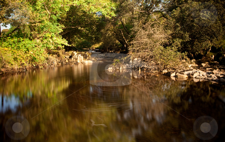 Slow motion water in secluded river stock photo, Broad river pool in slow motion in verdant valley by Steven Heap