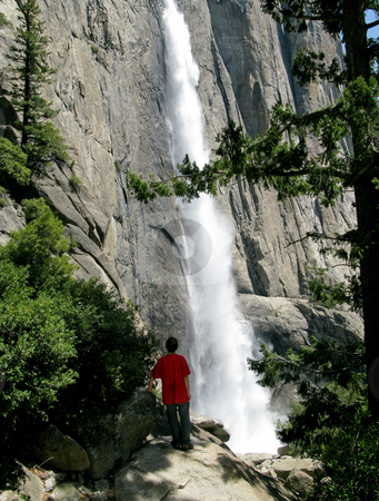 Hiker overlooking main flow of Yosemite Falls stock photo, View of the Yosemite Falls from hike alongside the waterfall by Steven Heap