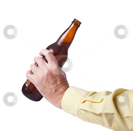 Brown bottle of beer in old hand stock photo, Brown bottle of cold beer being prepared for drinking by Steven Heap