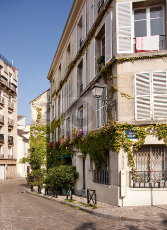 Old cobbled street in Montmartre in Paris stock photo, Old Parisian street with blossoms and cobbled road in suburb of Montmartre by Steven Heap