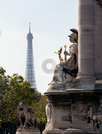 Eiffel tower framed by statue on Pont Alexandre Bridge stock photo, Statue on Pont Alexandre frames a distant hazy shot of the Eiffel Tower by Steven Heap