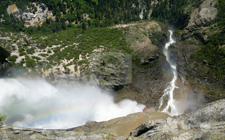 View from top of Yosemite Falls to the valley below stock photo, Vertical shot of the falling water down to the Yosemite Valley with rainbow by Steven Heap