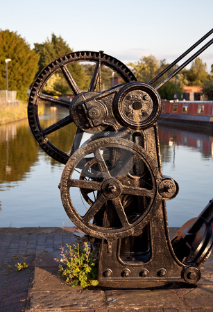 Old winch by canal in Ellesmere stock photo, Black steel crane by the waterside in Shropshire by Steven Heap