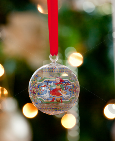 Glass ornament in front of Christmas tree stock photo, Hand painted glass ornament in front of out of focus tree by Steven Heap