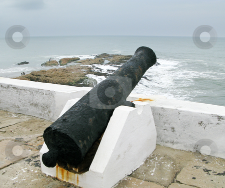 Elmina castle rusty gun overlooking ocean stock photo, Elmina Castle was the exit port for slaves from Ghana in Africa. This is a rusted cannon by Steven Heap