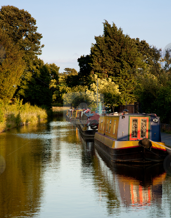 Old canal barges at Ellesmere stock photo, Row of canal barges on the river near Ellesmere in Shropshire by Steven Heap
