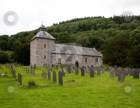 Melangell Church in North Wales stock photo, View across Graveyard to old stone church in north Wales by Steven Heap