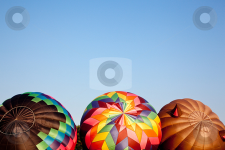 Three Hot air balloons being inflated stock photo, Three colorful hot air ballons being set up for a flight by Steven Heap