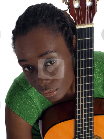Pretty young black woman holding accustical guitar stock photo, Young African American holding guitar by Jeff Cleveland