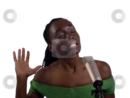 Young black woman at microphone eyes closed stock photo, Young African American Woman singing at microphone by Jeff Cleveland
