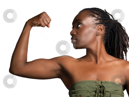 Young black woman profile showing biceps stock photo, Young African American woman showing bicep muscle by Jeff Cleveland