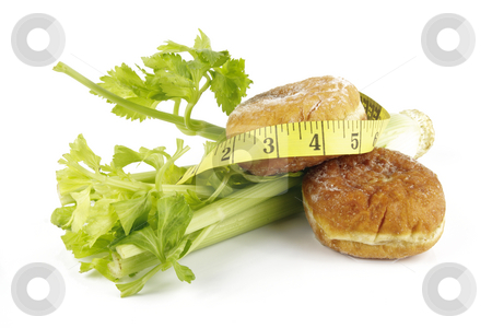 Celery and Jam Doughnut with Tape Measure stock photo, Contradiction between healthy food and junk food using celery and jam doughnut with a yellow tape measure on a reflective white background by Keith Wilson
