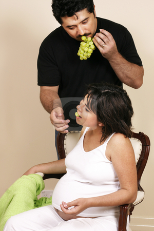 Feeding her grapes stock photo, Feeding his wife grapes by Leah-Anne Thompson