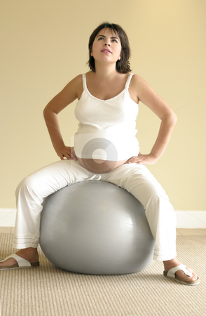 Pilates for pregnancy stock photo, Light pilates exercises help ease discomfort for pregnant women by Leah-Anne Thompson