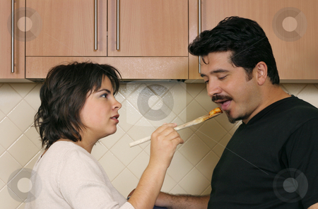 Taste stock photo, A woman offers pasta to her husband by Leah-Anne Thompson