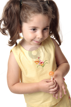 Shy toddler girl smiling stock photo, A toddler girl dressed in a yellow outfit smiles shyly by Leah-Anne Thompson