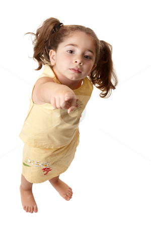 Young little girl pointing finger stock photo, A young girl standing and with one arm outstretched is pointing her finger by Leah-Anne Thompson