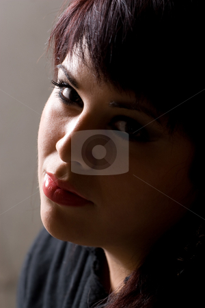 Glamorous Girl stock photo, A pretty young hispanic woman under dramatic lighting. by Todd Arena