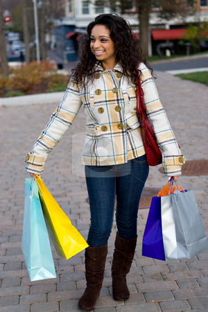 Woman Shopping stock photo, A young shopaholic out shopping in the city. by Todd Arena