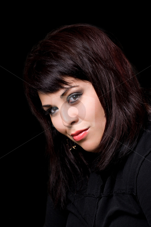 Pretty Woman stock photo, A pretty young hispanic woman under dramatic lighting. by Todd Arena