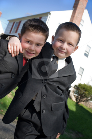 Best Buddies stock photo, Two happy young boys dressed in suits with smiles on their faces. by Todd Arena