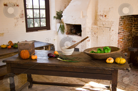 Old kitchen table in plantation building stock photo, Old kitchen table showing vegetables in front on brick fireplace by Steven Heap