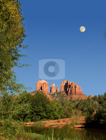 Moon rising over Cathedral Rocks in Sedona stock photo, View of Cathedral Rocks in Sedona with water in foreground and moon in sky by Steven Heap