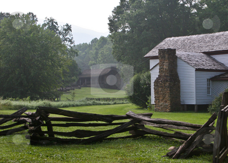 White framed farm buildings stock photo, White wooden farm buildings with rustic fence in Smoky Mountains by Steven Heap