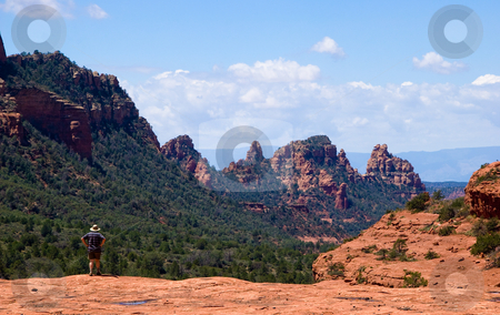 Single hiker in Sedona stock photo, Rear shot of single hiker overlooking the red rock in Sedona by Steven Heap