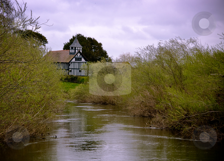Melverley Church Reflection stock photo, Reflection of half-timbered Melverley Church in the adjacent river Vrynwy by Steven Heap
