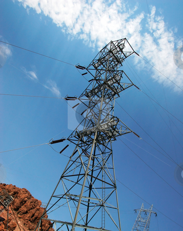Electricity Pylon stock photo, View upwards towards the top of an electric pylon against blue sky by Steven Heap