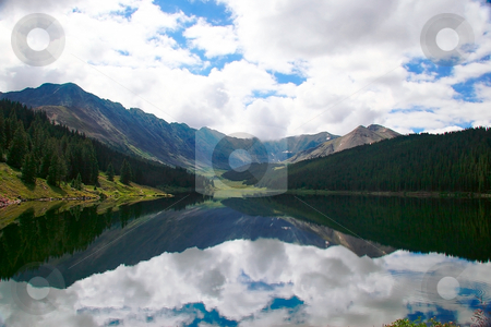 Lonely lake reflecting mountains stock photo, Sierra Mountains reflected in still lake by Steven Heap