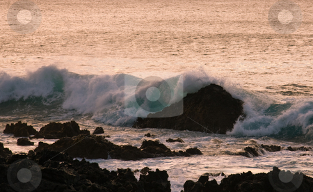 Crashing waves on rock in sunset stock photo, Waves off the coast of Hawaii crashing on rocks at sunset by Steven Heap