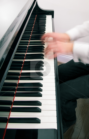 Pianist hands playing the grand piano stock photo, Ghostly hands on piano by Steven Heap